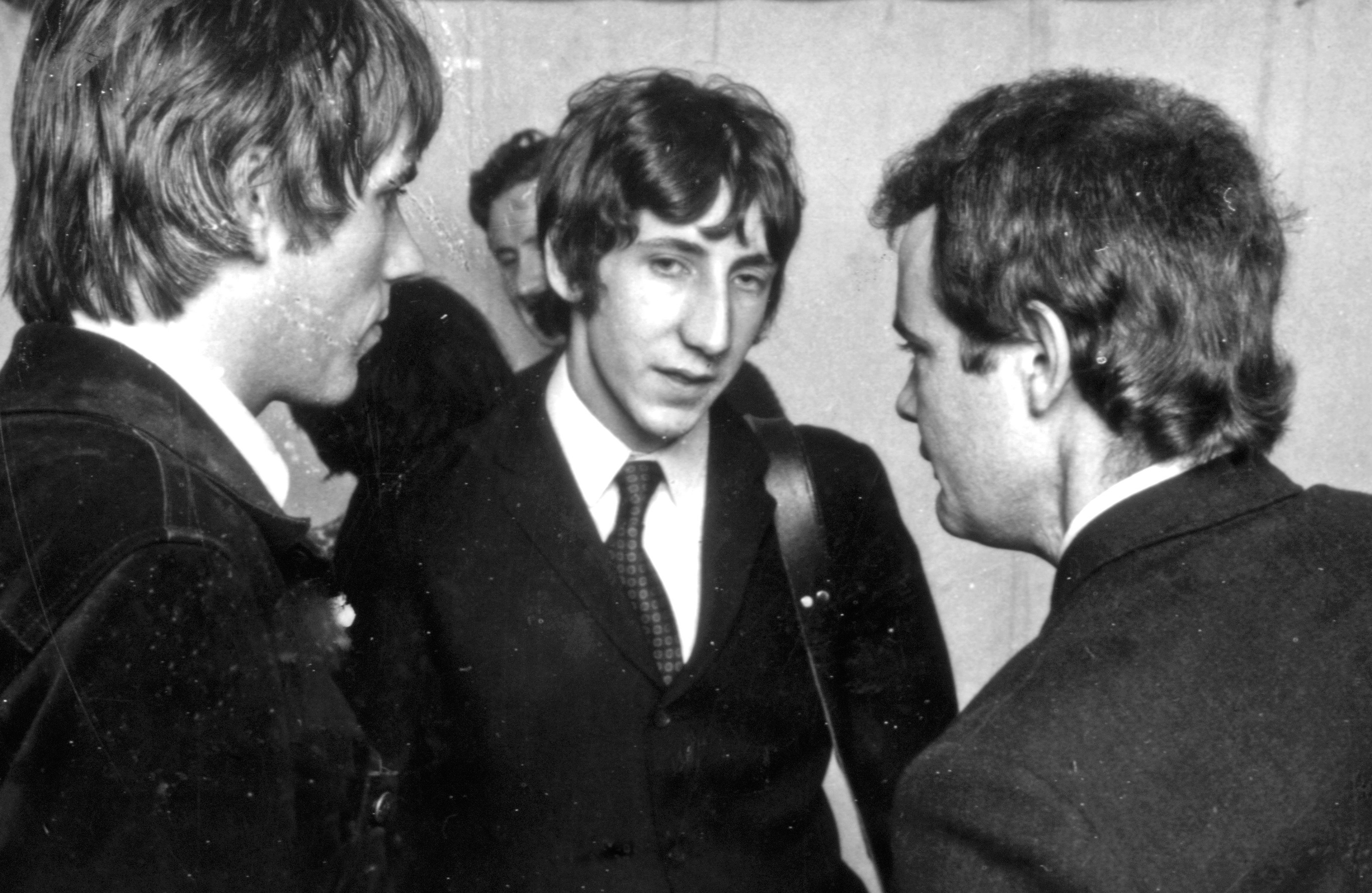 THE WHO with Chris Stamp at left. Pete Townshend and Kit Lambert at Windsor Jazz Festival in 1966