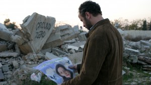 Amin-Holding-Martyr-Poster-of-Siham