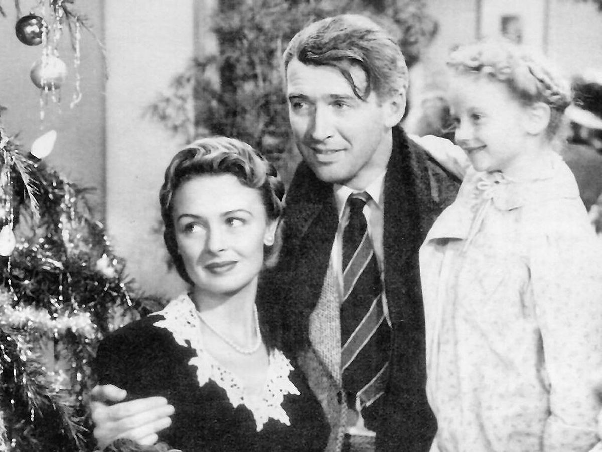"George Bailey (James Stewart), Mary Bailey (Donna Reed), and their youngest daughter Zuzu (Karolyn Grimes) in ""It's A Wonderful Life"""